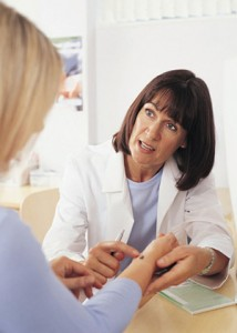 Patient consulting a dermatologist